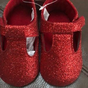 Little girl red shoes